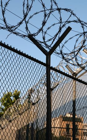 jail fence with barbed wires for protection Stock Photo - 3262828
