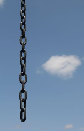 unleashed: an opened broken chain over a blue clouded sky