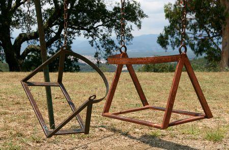 broken chair: broken childs swing chair on a park