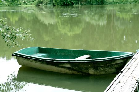 peacefull: abandoned green boat at the river, peacefull landscape. Stock Photo