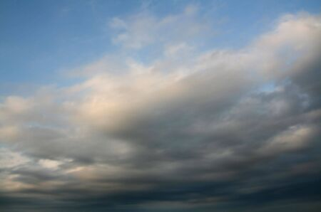 stormy weather at summer, dark clouds over blue sky photo