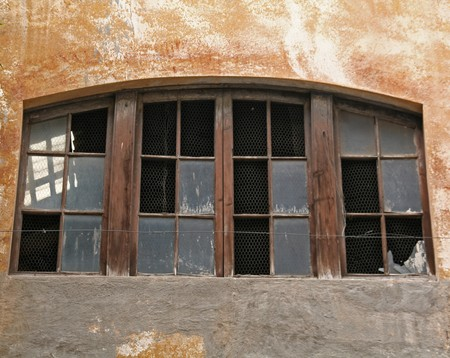penury: broken window and old wall