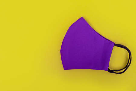 Purple masks on yellow background. Top view