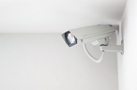security safety: cctv camera on the white wall, a security system.