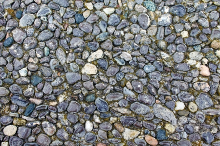 Seamless background of small stones. photo