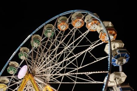 Colorful ferris wheel at night 스톡 콘텐츠