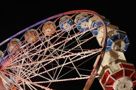 horizental: Stationary ferris wheel at night Stock Photo