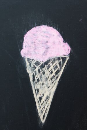 Chalk drawing of an ice cream cone on a blackboard. photo