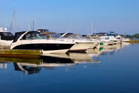 boat motor: Yachts anchored at marina Stock Photo