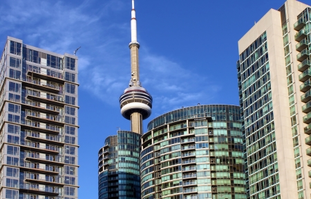CN Tower and residential buildings against blue sky, Toronto, Ontario, Canada Stock Photo - 21417278