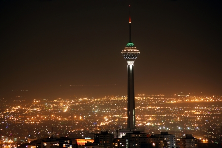 Tehran skyline and illuminated Milad Tower at night, Tehran, Iran