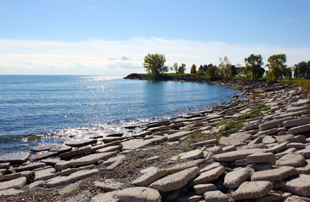 coastal erosion: Rocky beach of sparkling Lake Ontario