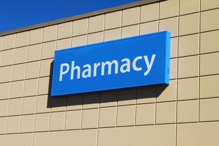 shop sign: Pharmacy sign on a building facade