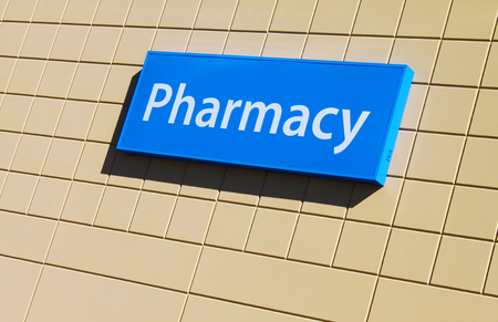 Pharmacy sign on a building facade photo