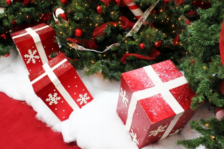 Red gift boxes under the Christmas tree
