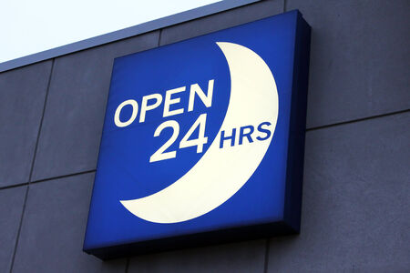 convenience: Illuminated blue open 24 hours sign Stock Photo