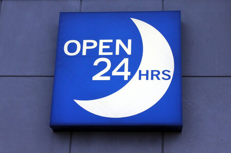 long hours: Illuminated blue open 24 hours sign Stock Photo