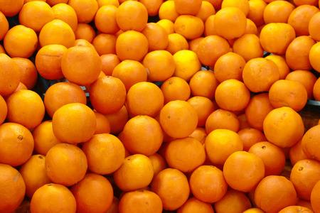 Pile of fresh oranges photo