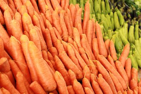 Variety of fresh vegetables on market stalls