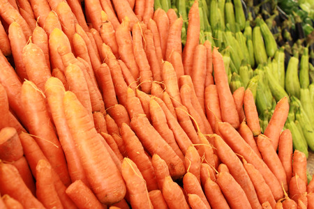 Variety of fresh vegetables on market stalls photo