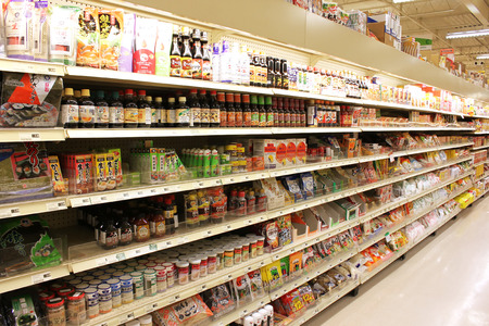 store shelf:  View of an Asian grocery store shelves with variety of products