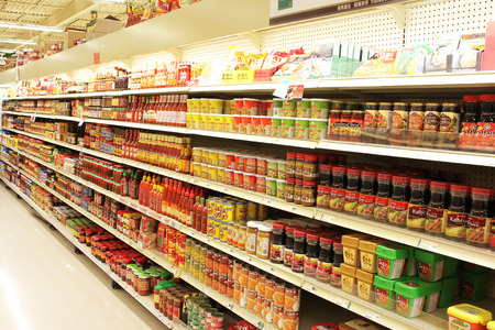Variety of products on the shelves of an Asian supermarket