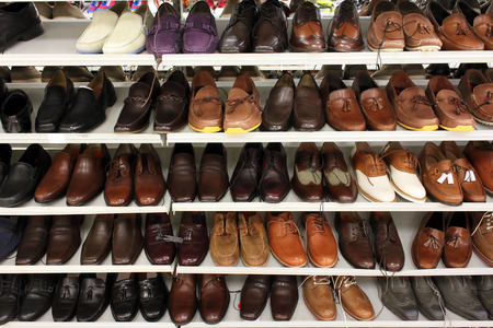 closet: Variety of leather shoes in a shop Stock Photo