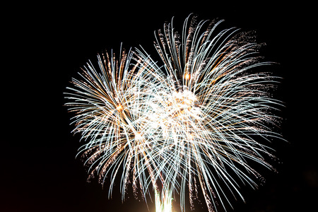 Flowing fireworks over the night sky 스톡 콘텐츠