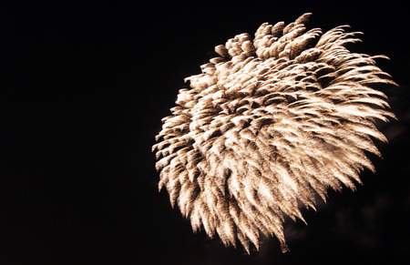 Flowing fireworks at a windy night photo