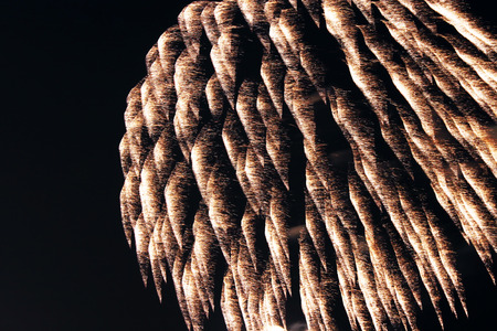 Close up of flowing fireworks at a windy night