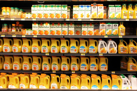 Different brands of orange juice in a supermarket
