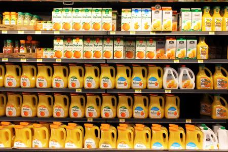 store shelf: Different brands of orange juice in a supermarket