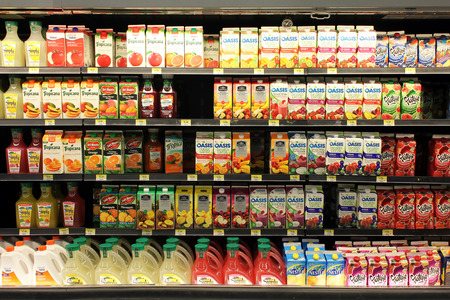 the juice: Fruit juices on shelves in a supermarket