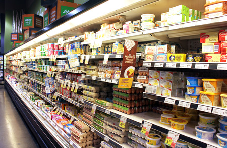 fridge: Eggs and dairy products on shelves in a supermarket
