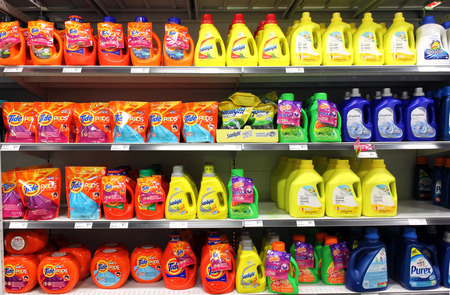 shelves: Different types of detergents on shelves in a supermarket