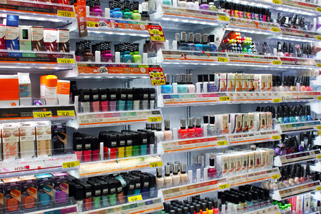 Variety of cosmetic products and nail colors on display in a store