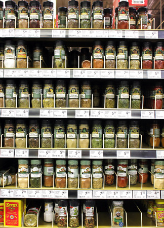 spice: Various spices and seasoning powders on shelves in a supermarket