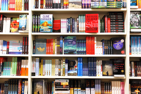 Books on shelves in a bookstore 에디토리얼