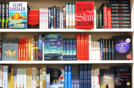 Novels and fictions on shelves in a  bookstore