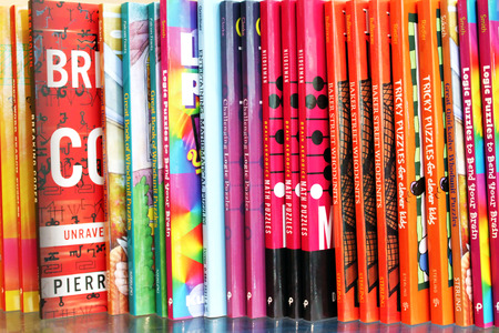 Close up of a variety of children puzzle books on display in a bookstore