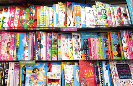 publisher: Children drawing books on shelves in a book store