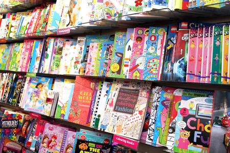 Children drawing and coloring books on shelves in a book store