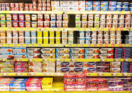 Yogurt selection on shelves in a supermarket