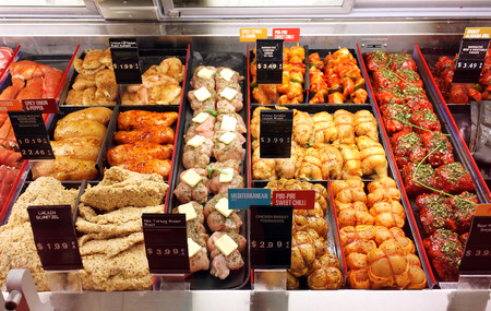 Selection of different cuts of fresh raw meat and ready-to-cook meals in a supermarket