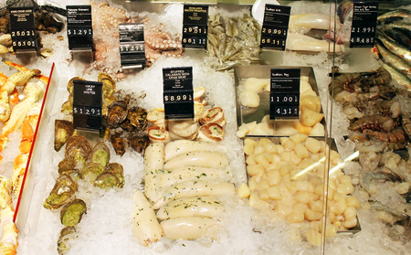Fresh seafood on display at a supermarket