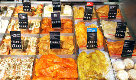 Marinated and ready-to-cook fish and seafood in a supermarket