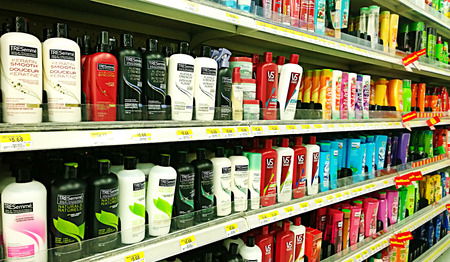 Bottles of shampoo and cosmetic products on shelves at a supermarket