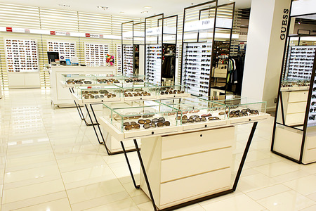 Selection of designer eyewear and sunglasses in an optician store 에디토리얼
