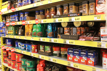Assorted coffee on display in a grocery store