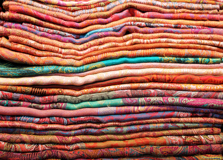 Close up of a colorful stack of cloth fabrics